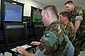 US Navy 050810-N-0057D-003 A team of intelligence Specialist analyze maritime traffic using the Navy Reserve's Littoral Surveillance System.jpg