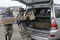 US Navy 050910-N-1467R-013 Mexican Sailors assigned to the Mexican amphibious ship ARM Papaloapan (P-411), work together as they load a car with boxes of water at the Red Cross distribution center in Biloxi, Mississippi.jpg