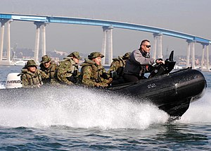 US Navy 060112-N-2613R-080 Marine Staff Sgt. David Cleaves, an instructor with Expeditionary Warfare Training Group Pacific, drives a Combat Inflatable Craft, (CRIC), with soldiers from Japan Ground Self-Defense Force.jpg