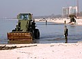 US Navy 060302-N-9246W-006 Personnel assigned to Naval Mobile Construction Battalion Seven Four (NMCB-74) use front end loaders to clear debris buried in the sand along the Gulf of Mexico shoreline.jpg