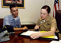US Navy 060412-N-7781S-002 Senior Chief Yeoman Carrie Persiani talks with Yeoman 3rd class Matthew Purpura assigned to the Broadarrows of Patrol Squadron Six Two (VP-62) to discuses career opportunities.jpg