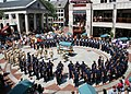 US Navy 060823-N-5367L-004 Chief petty officer (CPO) selectees sing Anchors Away in front of hundreds of spectators in Quincy Market, during their 3rd day of CPO leadership training.jpg