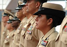 U.S. Navy chief petty officers wearing the Service Khaki uniforms with the  soon-to-be discontinued female