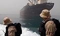 US Navy 070603-N-0684R-107 Sonar Technician (Surface) 2nd Class Kim Ditzel, left, and Boatswain's Mate 1st Class Jared Klevens watch as their rigid hull inflatable boat approaches an international oil tanker in the Persian Gulf.jpg