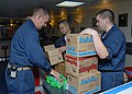 US Navy 070709-N-3211R-013 Master Chief Quartermaster Larry L. Irwin distributes Girl Scout cookies to Sailors aboard amphibious assault ship USS Bonhomme Richard (LHD 6).jpg