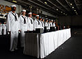 US Navy 070819-N-7981E-332 Flag bearers stand by with flags and urns prior to a burial at sea ceremony aboard Nimitz-class aircraft carrier USS Abraham Lincoln (CVN 72).jpg