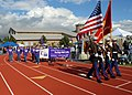 US Navy 080606-N-9860Y-004 Members of the Marine Aviation Training Support Group 53 color guard lead the opening lap of cancer societies around the Oak Harbor Middle School track.jpg