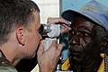 US Navy 080812-N-9774H-121 Lt. Johnny Cosby, a Navy augmentee working as an optometrist aboard the amphibious assault ship USS Kearsarge (LHD 3), conducts an eye exam on a patient.jpg