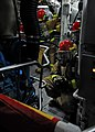 US Navy 080827-N-0807W-368 A hose team enters auxiliary room number one during a main space fire drill..jpg