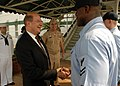 US Navy 080925-N-0491H-025 Secretary of the Navy (SECNAV) The Honorable Donald C. Winter shakes the hand of Yeoman 2nd Class Akaiya M. Miller during his visit to Fleet Activities Sasebo.jpg