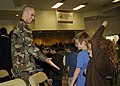 US Navy 081107-N-9584H-023 A Seabee from Naval Mobile Construction Battalion (NMCB) 3 greets a student at Tierra Linda Elementary School.jpg