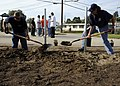 US Navy 081122-N-9584N-002 Chief Steel Worker Allen Egelston and Senior Chief Utilitiesman Jamie Rainwater work together to dig a ditch during a community relations project.jpg