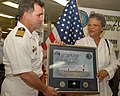US Navy 090411-F-7751S-132 Capt. Bob Lineberry, Continuing Promise 2009 mission commander, presents a plaque to Haitian Prime Minister Michele Pierre-Louis.jpg