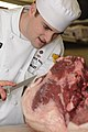US Navy 090416-N-4515N-021 Culinary Specialist 1st Class William Foster, assigned to Cross Hall Galley in Groton, Conn., butchers a slab of beef during the first Navy Region Mid-Atlantic Iron Chef Competition at Naval Station N.jpg