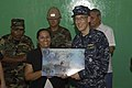 US Navy 090713-F-7923S-232 Capt. Thomas M. Negus, Continuing Promise 2009 mission commander, presents a mission plaque to the principal of the Villanueva School renovated by Construction Battalion Maintenance Unit (CBMU) 202 Se.jpg