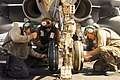 US Navy 100128-N-3327M-254 Sailors change tires on an aircraft aboard USS Nimitz.jpg