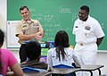 US Navy 100227-N-1906L-001 Information Systems Technician 1st Class Christopher Castillo and Senior Chief Information Systems Technician Steven Dupree complete the Saturday Scholars tutoring program at Vicente S.A. Benavente Mi.jpg