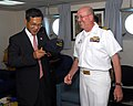 US Navy 100616-N-4007G-021 Capt. Jeffrey W. Paulson presents a command ball cap to Japanese Ambassador to Cambodia Masarumi Kuroki.jpg