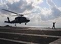 US Navy 101206-N-5538K-234 An SH-60S Sea Hawk helicopter lands aboard the aircraft carrier USS George Washington (CVN 76).jpg