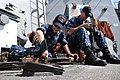 US Navy 110309-N-9818V-039 Gunner's Mate Seaman Recruit Erikka Macon conduct maintenance on the .50-caliber machine gun aboard USS Decatur (DDG 73).jpg