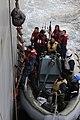 US Navy 110325-N-6692A-084 Capt. Sal Aguilera, chaplain for U.S. 7th Fleet, climbs aboard the amphibious dock landing ship USS Germantown (LSD 42).jpg