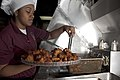 US Navy 110403-N-QP268-017 ulinary Specialist 3rd Class Kiara Carter prepares a platter of chicken wings for the wardroom aboard USS Whidbey Island.jpg