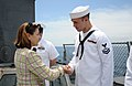 US Navy 110518-N-AQ172-162 U.S. Representative Loretta L. Sanchez meets Aviation Electrician's Mate 2nd Class Jason Cummings during a tour aboard U.jpg