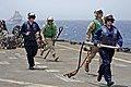 US Navy 110607-N-RC734-172 Sailors run to clear cargo pendants from the flight deck aboard USS Comstock (LSD 45) during a vertical replenishment.jpg