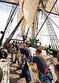 US Navy 110619-N-AU127-377 Sailors assigned to USS Constitution heave a line during sail training aboard Friendship of Salem.jpg