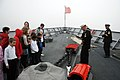 US Navy 110703-N-MU720-202 Boatswain's Mate 1st Class Samuel Siemers talks about the capabilities of USS Ford (FFG 54) to children from the Parus N.jpg