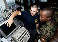 US Navy 110726-N-OV802-072 Quartermaster Seaman Kyle Seaux trains Tanzanian navy Lance Cpl. S.K. Rutungu in navigation.jpg