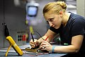 US Navy 111021-N-XE109-186 Aviation Electronics Technician Airman Cristina N. Mace tests resistors on a circuit card aboard the aircraft carrier US.jpg