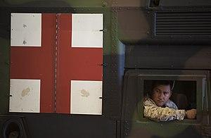US Navy 120209-N-PB383-356 Hospital Corpsman 3rd Class Roel Espina prepares to embark a landing craft, air cushion.jpg