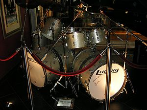 "Bass drum - Bass drums with ""woofers"" or additional resonating sections attached to enhance tone and depth. Drum set used by Alex Van Halen"