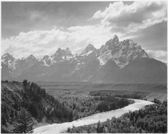 "View from river valley towards snow covered mountains, river in foreground from left to right, ""Grand Teton"" National Pa - NARA - 519905.tif"
