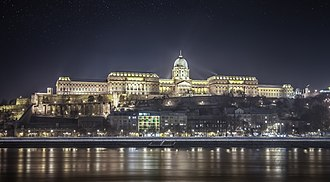 Budapest - Buda Castle at night viewed from Danube Promenade