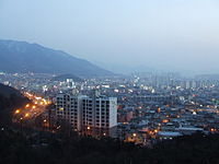 View of Dalseo-gu in Daegu from Daegu Duryu Park.JPG