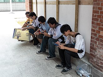 Internet addiction disorder - People using their smartphones.