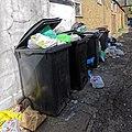 Wheelie bins overflowing rubbish Dongola Road Tottenham London England 1.jpg