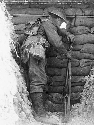 1908 Pattern Webbing - A British soldier in France during the Battle of the Somme, 1916. Visible parts of his 1908 webbing in Battle Order are the haversack, which is being worn on the back in place of the valise, the entrenching tool carrier, the water bottle, and the ammunition pouches towards the front of his waist.