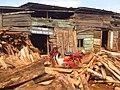 Y Coetsee Motorcycle with timber words Uganda (2013).jpg