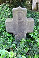 Grave cross at the well