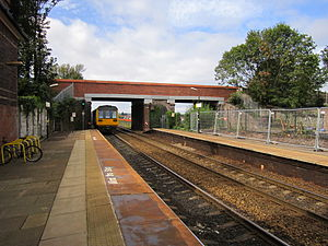 Roby railway station - Image: 142036 departs Roby