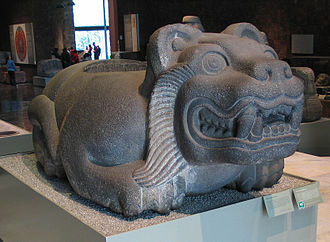 Human sacrifice in Aztec culture - A jaguar-shaped cuauhxicalli in the National Museum of Anthropology.  This altar-like stone vessel was used to hold the hearts of sacrificial victims.  See also chacmool.