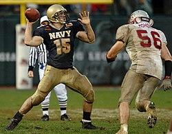 Navy quarterback Aaron Polanco sets up to throw.