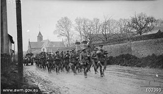 27th Battalion (Australia) - Members of the 27th Battalion marching through Beaucourt-sur-l'Ancre in the Somme, France, 7 April 1918