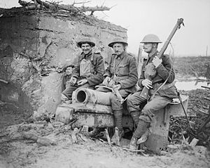 Guards Division (United Kingdom) - Four men of the 4th (Pioneer) Battalion, Coldstream Guards perched on a wrecked gun outside a German concrete blockhouse on the outskirts of Houthulst Forest, Belgium, 9 October 1917.