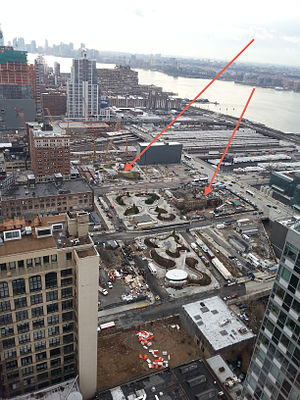 7 Subway Extension - Overview of subway construction area with arrows pointing to the entrances. (Left arrow points to main 34th Street entrance; right arrow, secondary 35th Street entrance.)