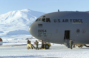 7th Airlift Squadron - Boeing C-17A Globemaster III 98-0054 flown by members from the 7th Airlift Squadron, sits on the sea-ice parking ramp at McMurdo Station, Antarctica,