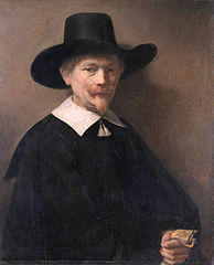 Portrait of a man with gloves in hand